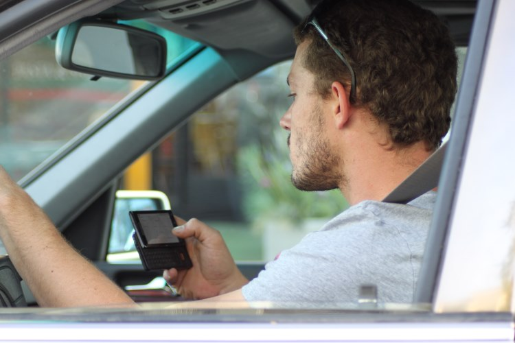 Heavier fines to be introduced in clampdown on drivers using mobile phones at the wheel.